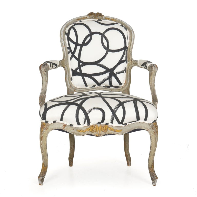 French Louis XV period worn gray painted fauteuil circa late 18th-early 19th century; with parcel gold highlights Item # 008EXP26I-3  A gorgeous painted fauteuil of the Louis XV period, this delightful chair has a historical surface of many