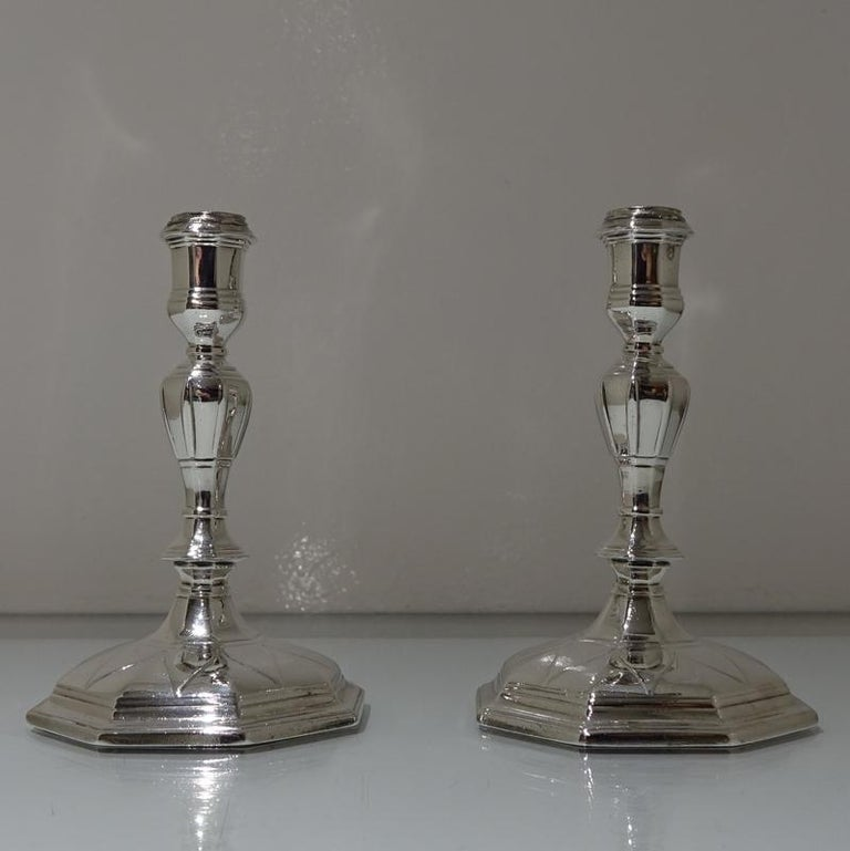 "An incredibly rare pair of early 18th century cast octagonal candlesticks. The bases have a stunning design of ""drooping leaf"" workmanship for low lights and the octagonal tapering stems have elegant ""ribbing"" around the central columns."