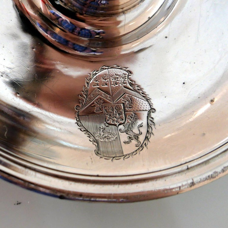 A very fine George II sterling silver chamberstick designed with an elegant plain formed circular drip pan. The centre front has a stylish contemporary armorial for importance.     Weight: 8.5 troy ounces/267 grams  Measures: Height 2.75