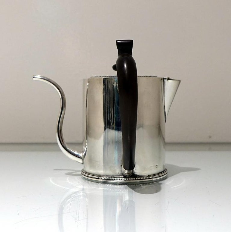"""A truly magnificent bead bordered plain formed Georgian silver """"drum"""" shaped argyle with a stylish tubed swan neck spout for decorative design. The detachable lid and centre front of the body have stylish contemporary crests for importance. The"""