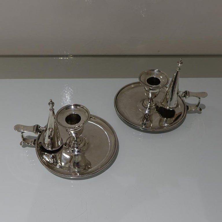 A collectable pair of 18th century circular bead border silver chamberstick's made by the highly renowned silversmith Hester Bateman. The detachable nozzles and conical snuffers have additional bead decoration.     Weight: 16.8 troy ounces/525