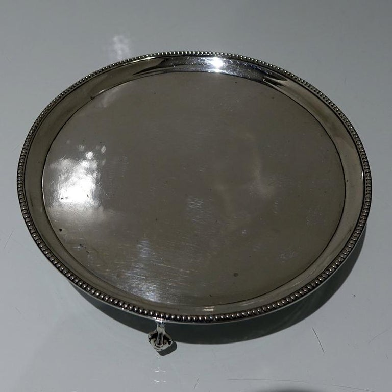 A rare and extremely collectable circular Hester Bateman bead salver sitting on three ball and claw feet.
