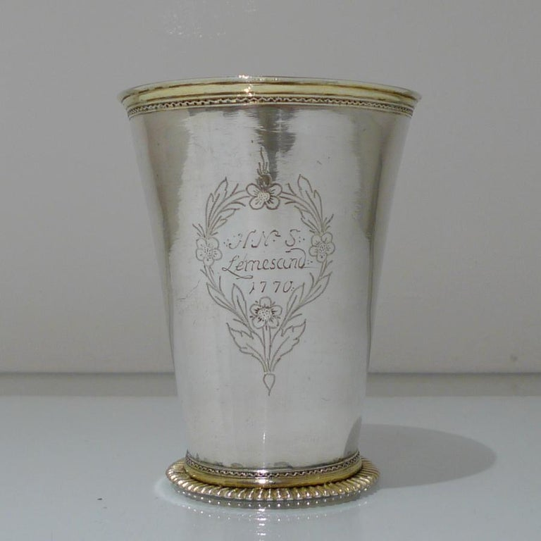 A beautifully designed large 18th century silver tapering formed beaker. The upper and lower sections have been gilded for decorative contrast and the inside has additional gilding. There is an engraved contemporary inscription and cartouche for
