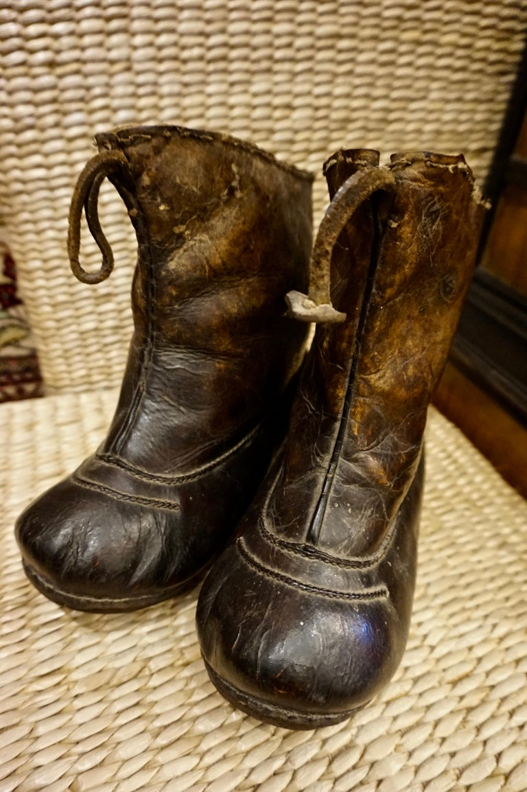 Very rare Asian handmade leather snow boots with metal studs. Unique conversation pieces that have stood the test of time and exude old world character,  circa late 1700s.