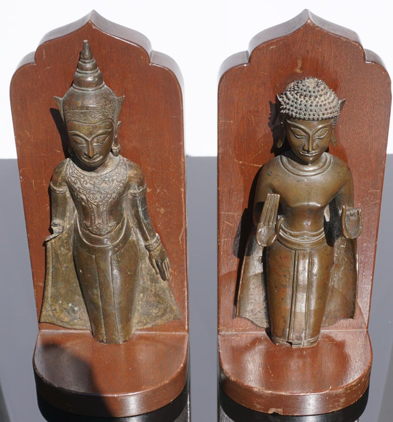 Extremely decorative; these authentic 18th century or earlier Ayutthaya period Thai bronze Buddhas were fashioned into bookends due to their losses of appendages and legs. Very detailed quality casts!