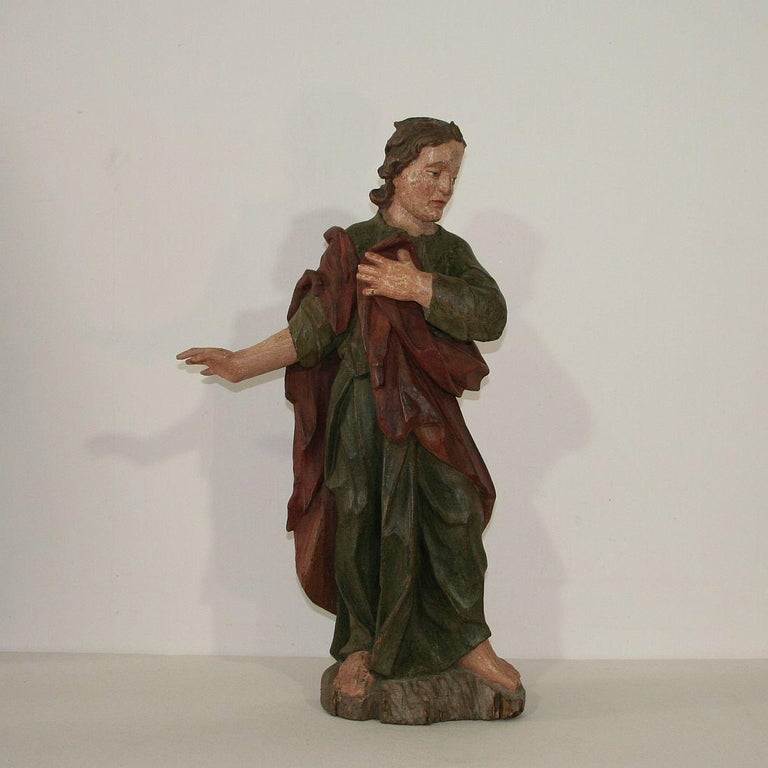 Very nice Baroque carved wooden saint figure with great old color, Germany, 18th century. Weathered, small losses and old repairs.