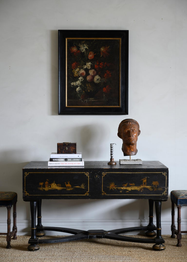18th century Swedish late Baroque chinoiserie console table with a storage compartment under the top, circa 1750 Sweden   The console has been re-lacquered circa 1830 and shows light scratches and wear from previous use but remains in fair
