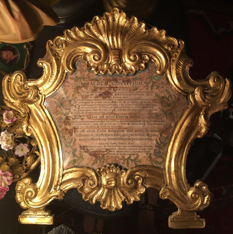 This original 18th century frame is gilded over copper. It is elaborately embossed and chiseled. The cartouche is surrounded by rocaille and volute motifs. The Carta is mounted on a wood backing and rests on two linear bases. It is very rare to find