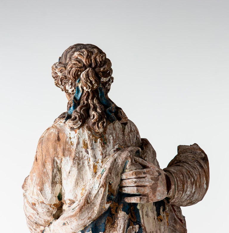18th century, Baroque, Italian school, sculpture carved in wood. European oak painted sculpture with patina, early 18th century. Probably part of a larger sculpture, you can see a hand holding her waist. Damage and color loss. The woman pictured