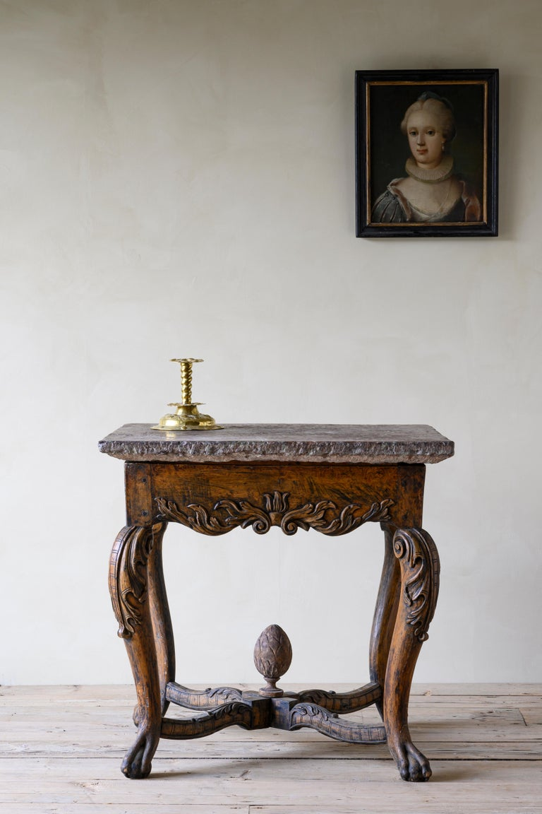 18th century Baroque stone top table with good proportions and fine carvings, North Europe / Scandinavia, circa 1740.