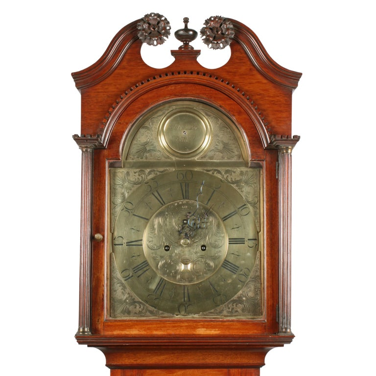 18th century brass dial grandfather clock.   A late 18th century Scottish walnut cased brass dial grandfather clock.  The clock has an eight day striking movement, a brass dial with a secondary second dial and a date aperture.  The clock has