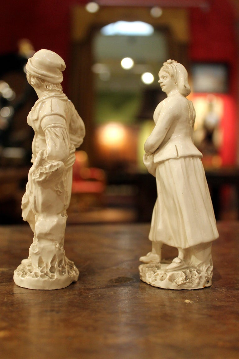 A pair of late 18th century Naples, real Fabbrica Ferdinandea, white porcelain figures of a lady and a man are hand modeled in the round. This lovely couple of statuettes in the white feature a fruit vendor and a peasant. The man, modelled in a