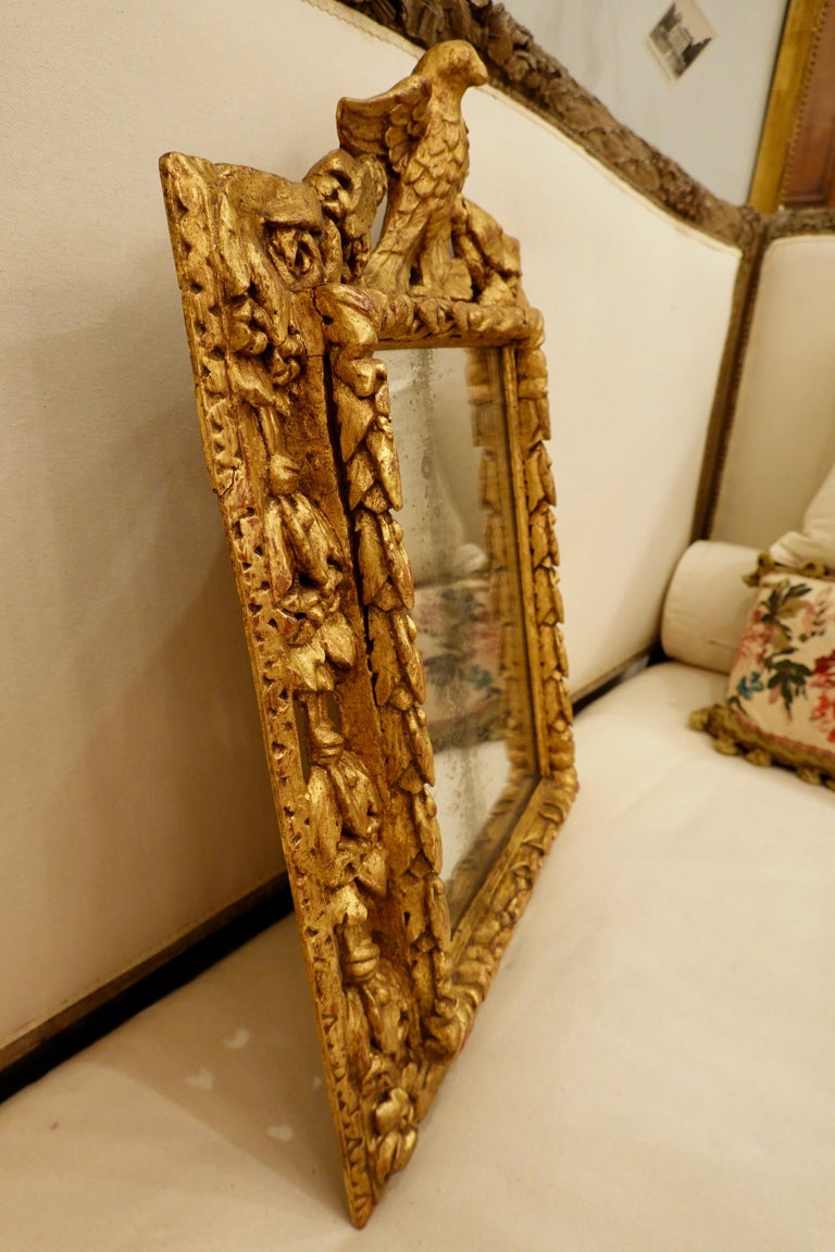 18th Century Carved Giltwood Mirror with Eagle, Roses and Leaves For Sale 4