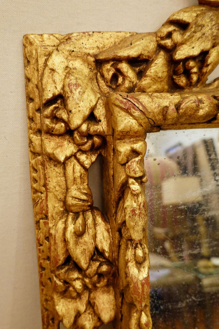 18th Century Carved Giltwood Mirror with Eagle, Roses and Leaves For Sale 5