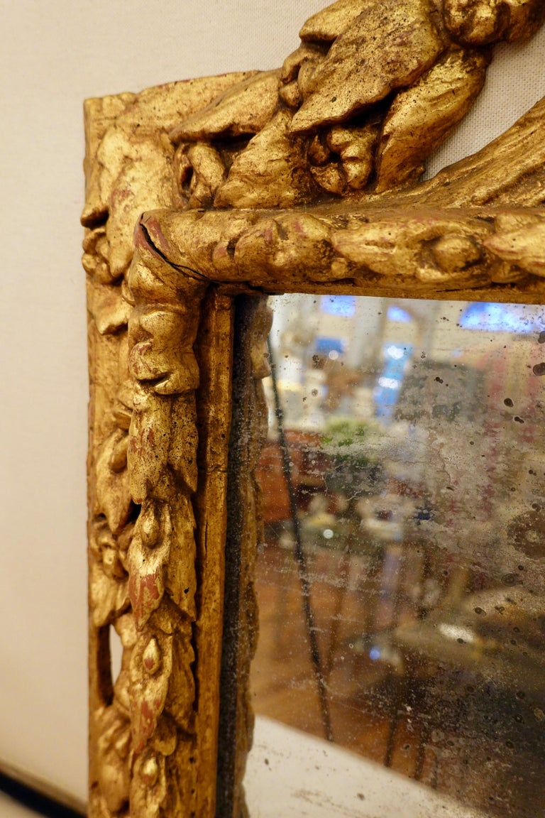 18th Century Carved Giltwood Mirror with Eagle, Roses and Leaves For Sale 6