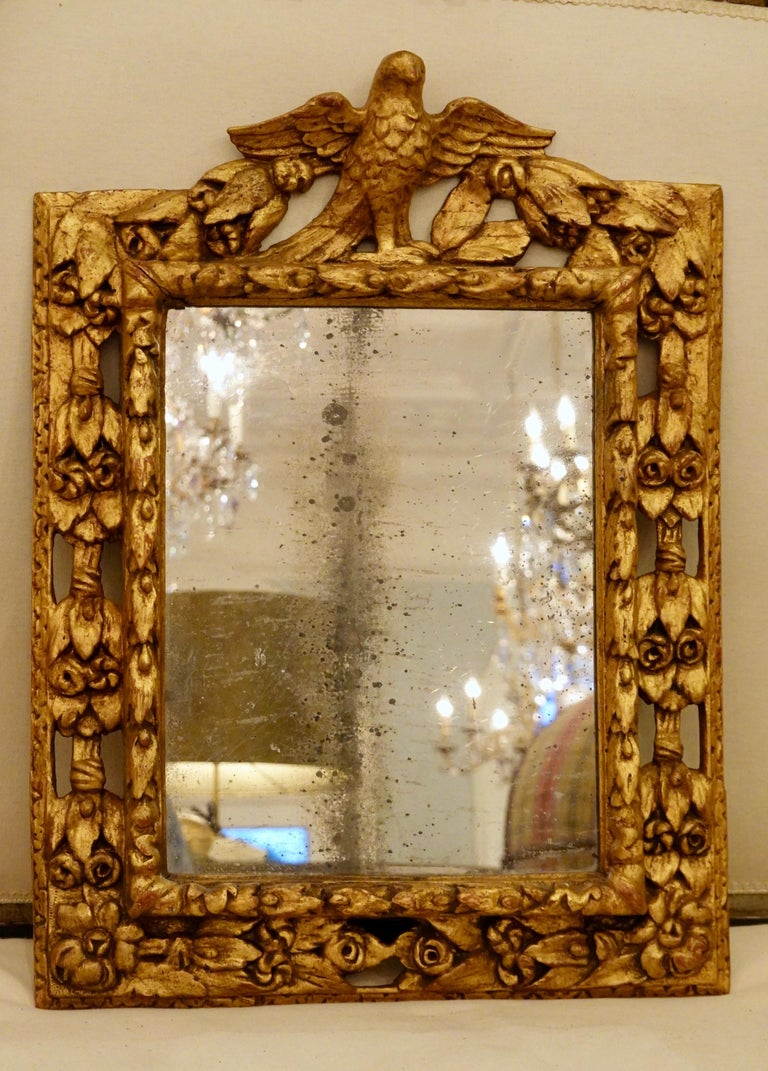 Baroque 18th Century Carved Giltwood Mirror with Eagle, Roses and Leaves For Sale