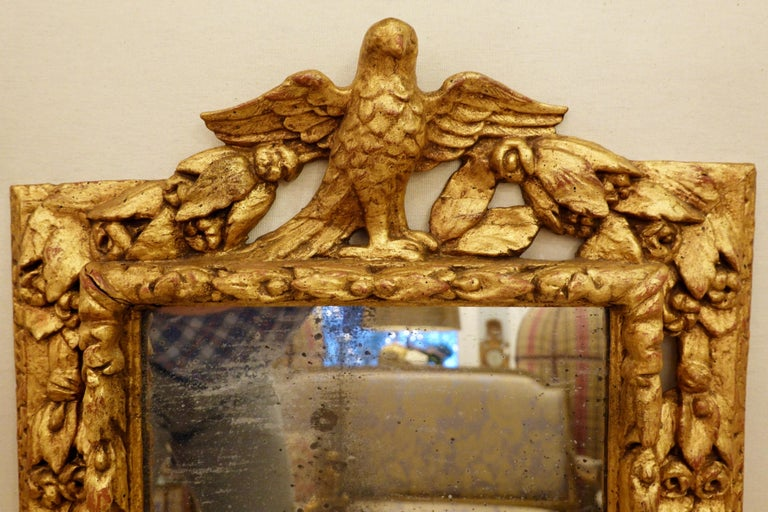 18th Century Carved Giltwood Mirror with Eagle, Roses and Leaves In Fair Condition For Sale In Charleston, SC