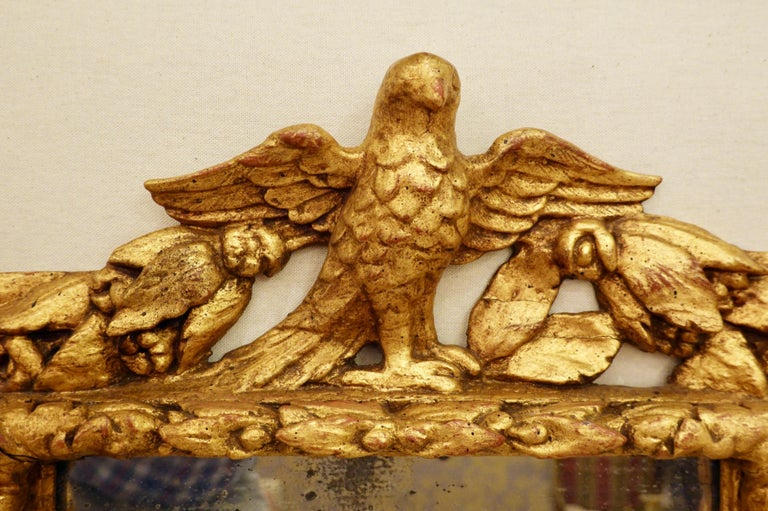 Gold Leaf 18th Century Carved Giltwood Mirror with Eagle, Roses and Leaves For Sale