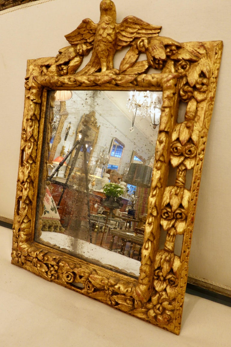 18th Century Carved Giltwood Mirror with Eagle, Roses and Leaves For Sale 3