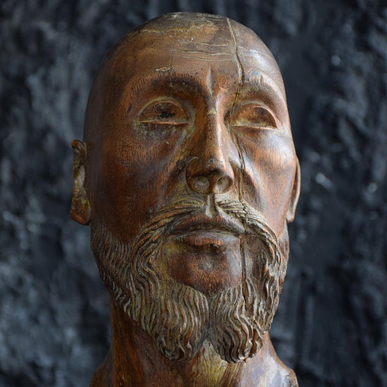 18th century carved wood Santos head We are proud to offer a wonderful example of a fine 18th century solid carved wooden Santos or Apostles head. Of exceptional quality with detail to beard and neck, with head turned to one side bears trace of