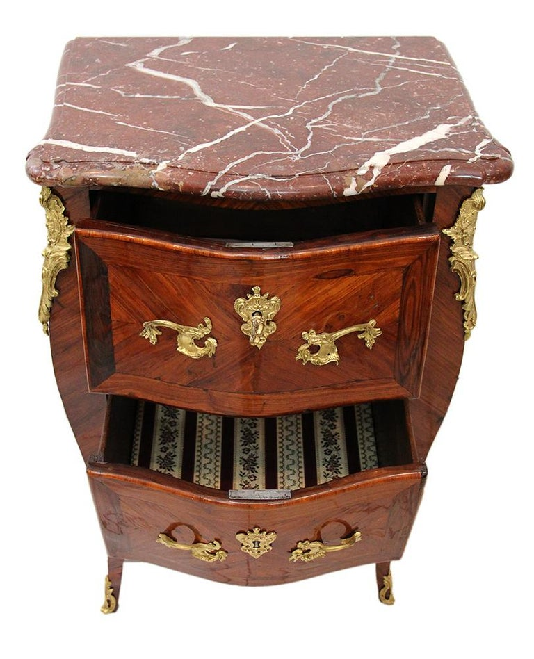 18th century chest of drawers Stamped BOUDIN with amaranth veneer and red marble Delicate little curved chest of drawers with red marble top from Flanders. Stamped Léonard BOUDIN, received master in 1761, collaborator of Pierre MIGEON.  Stamp of