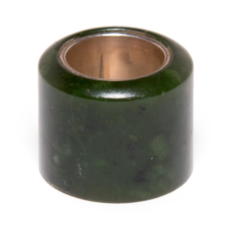 Hand carved of the highest quality jade, this 18th century Archer's ring was likely once worn by a gentleman-scholar in Northern China. Traditionally, Chinese archers wore these rings to protect their thumbs while drawing a bowstring. Over time,