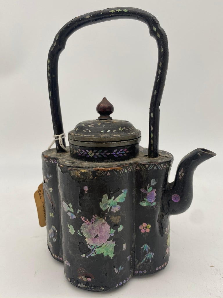 18th century Chinese lacquer mother of pearl inlay pewter teapot, height to handle top 8 inch, floral decoration as expected for age and use. Very beautiful and hard to find like this.