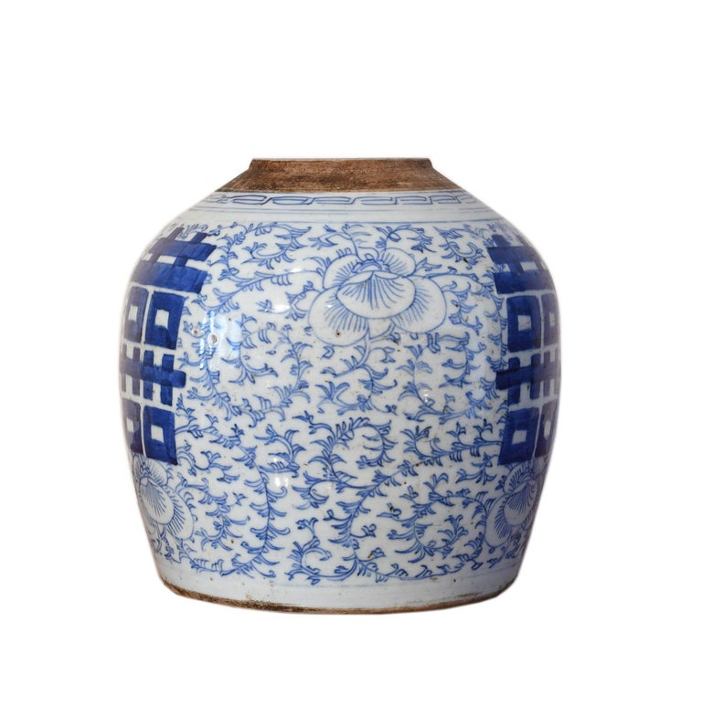 A Qing Chinese porcelain jar with hand painted cobalt blue decoration of