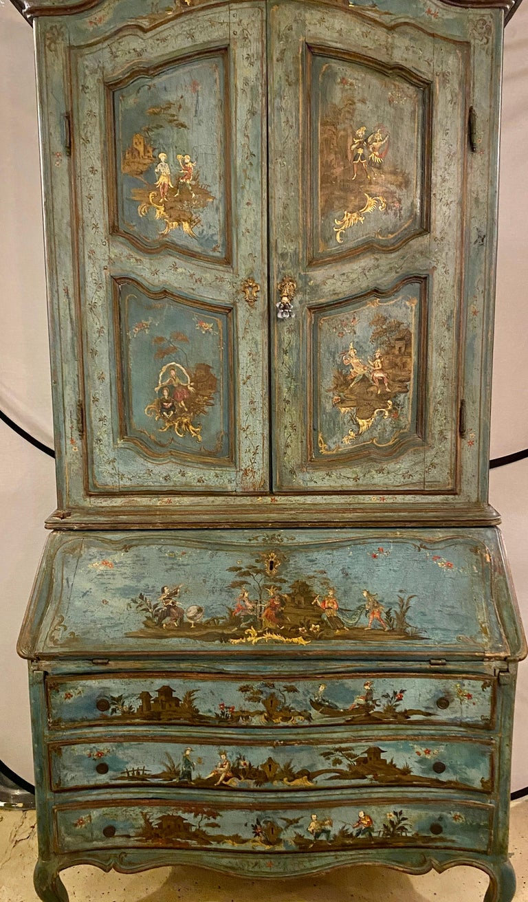 18th century chinoiserie Italian two piece secretary desk / bookcase. This spectacular one of a kind blu paint decorated 18th century chinoiserie Italian two-piece secretary desk is in exceptional condition considering its age. The three draw flip