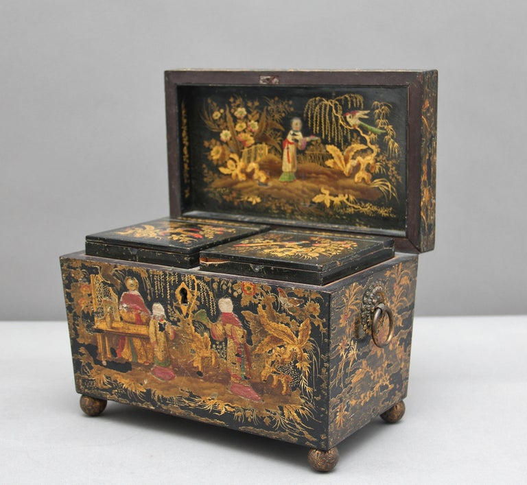A fabulous 18th century chinoiserie tea caddy superbly decorated with figures, foliage, flowers and birds, the interior with two lift out tea containers, the interior decoration is very crisp and bright, sadly the top has got some wear and one ring