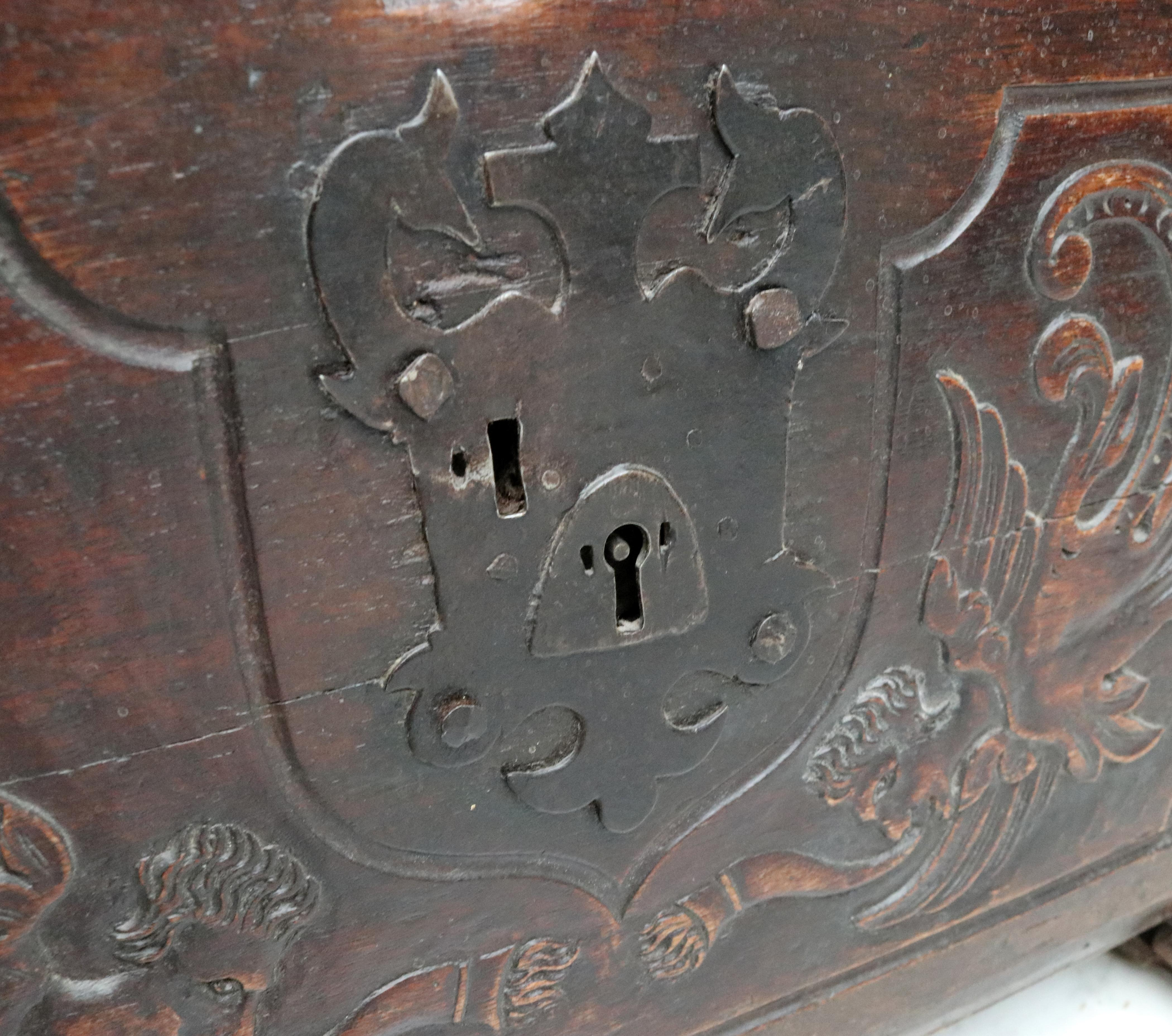 Th century colonial wooden chest with relief carvings and iron