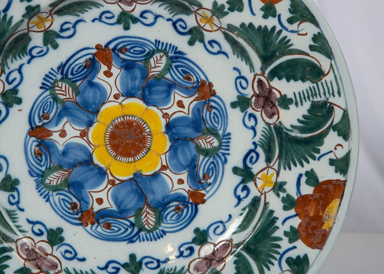 Hand-Painted 18th Century Delft Charger Hand Painted in Polychrome Colors Made circa 1780 For Sale