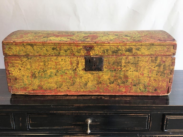 An early American dome-top box in original mustard yellow painted finish, late 18th century.