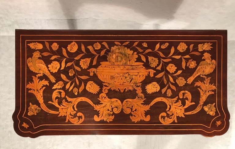 Exceptional 18th century Dutch card table, circa 1760. Beautiful marquetry with flowers and birds on the top and sides. The unfolded table shows inlays of an ornamental medaillion in the middle and one playing card in each corner. On each side of
