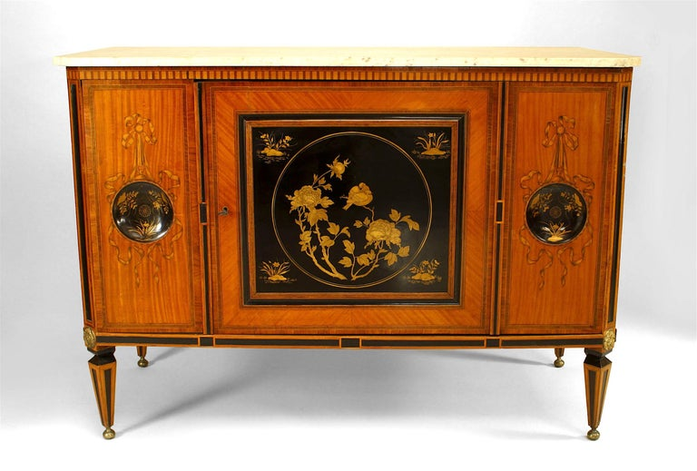 Late 18th century Dutch inlaid satinwood commode with two round decorated black lacquer panels centering a rectangular front panel, all raised upon four tapered, ball-footed legs.