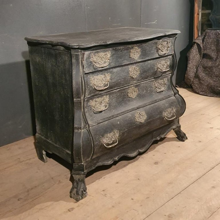 Good 18th century Dutch bombe 4-drawer commode painted in a distressed black, 1780.    Dimensions: 44 inches (112 cms) wide 24 inches (61 cms) deep 34 inches (86 cms) high.