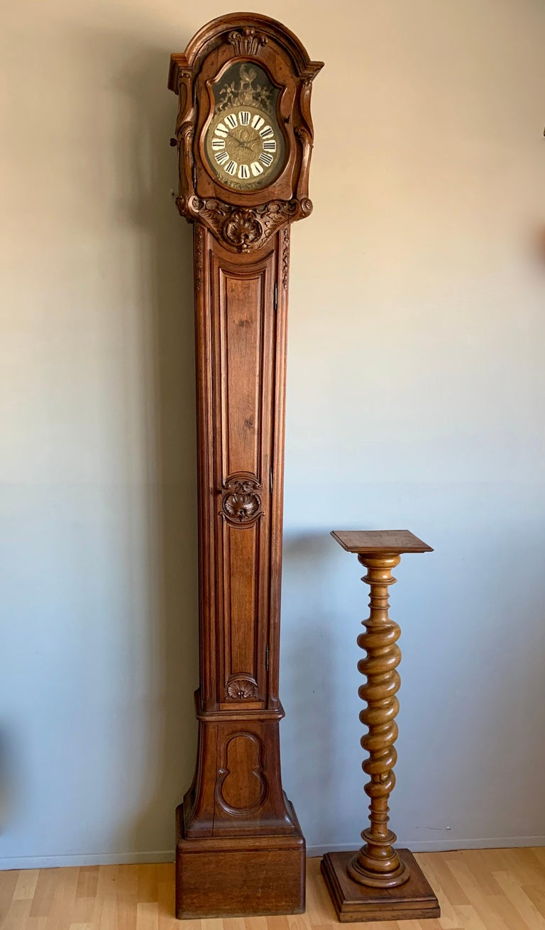 Stunning and completely original, antique oak grandfather or lantern clock, circa 1750.  This very old grandfather clock is one of the tallest we have ever seen and it has an amazingly elegant and slim design. It also features some of the most