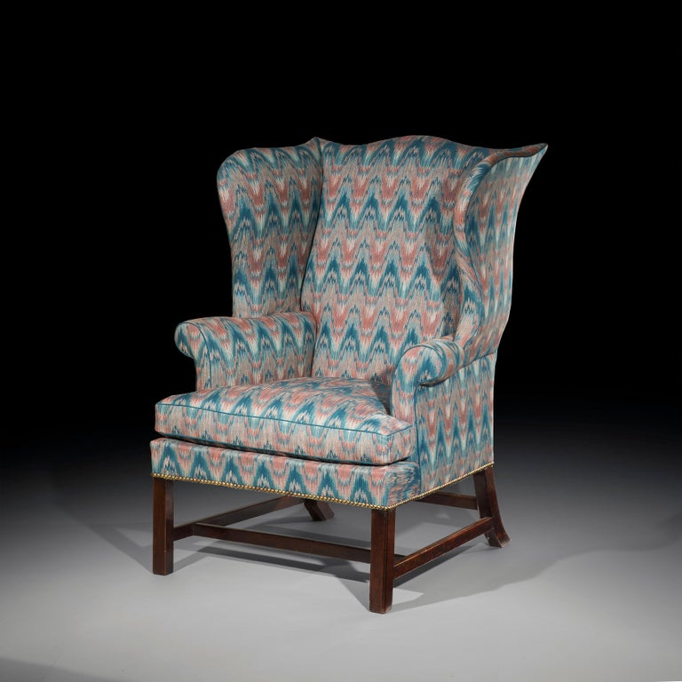 A super fine 18th century George III period Chippendale mahogany wingback library armchair, of exceptionally well-shaped outline and desirable generous proportions, English, circa 1760.  The serpentineback flanked byshaped side wings, over