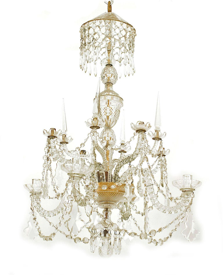 English Georgian 8 scroll arm cut crystal chandelier on 2 tiers with 4 arms with obelisks and 3 tiers of swags with a ball finial bottom (18th Century and latter additions).