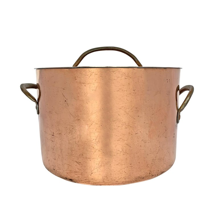 A beautiful large 20 quart, 3 mm thick, 18th century English hand-hammered copper stock pot with lid, both parts with heavy wrought iron handles. Both lid and pot are stamped with a