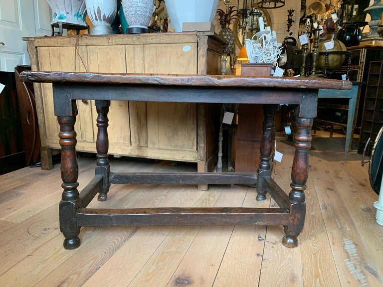 18th century English walnut hall table with four sided stretcher.