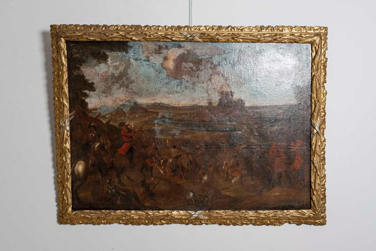 Baroque 18th Century European Oil Painting of a Battle Scene with a Carved Gilt Frame For Sale