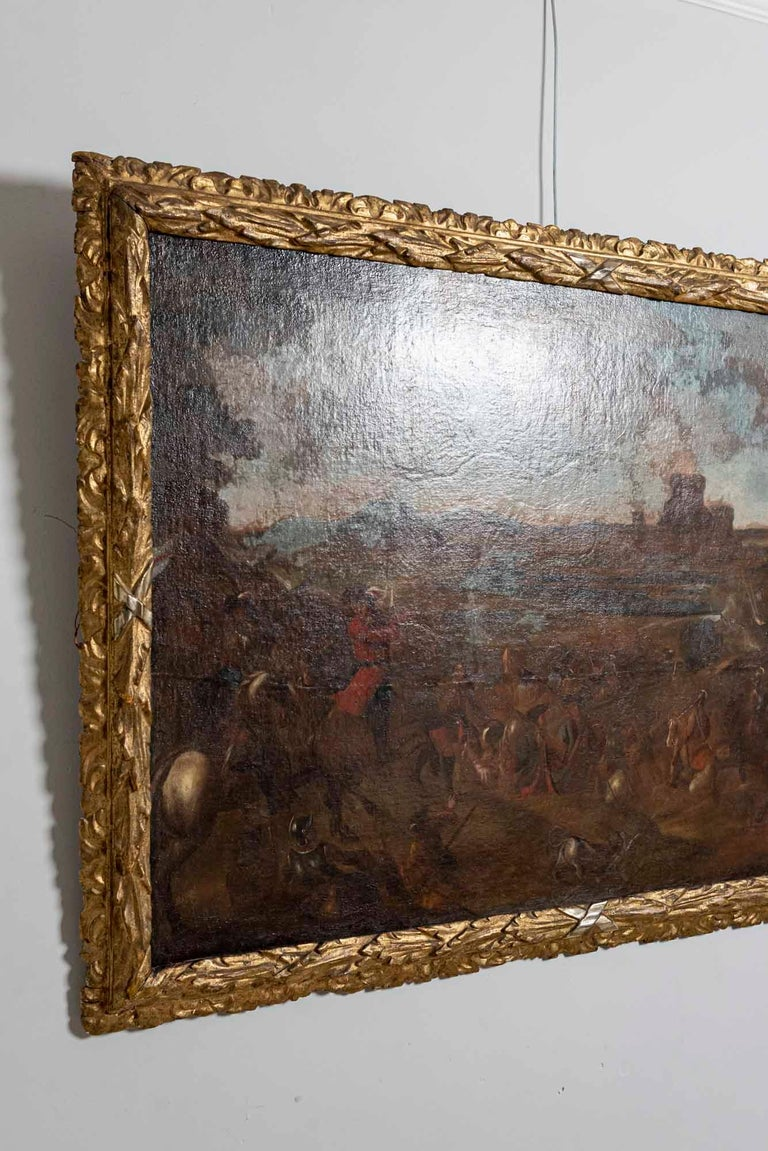 18th Century and Earlier 18th Century European Oil Painting of a Battle Scene with a Carved Gilt Frame For Sale