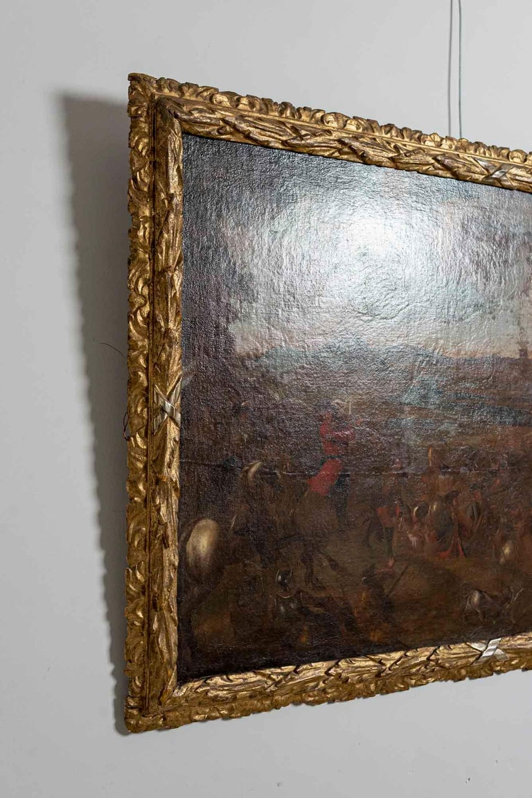 Canvas 18th Century European Oil Painting of a Battle Scene with a Carved Gilt Frame For Sale