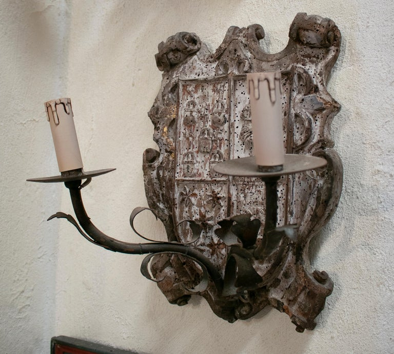 18th century European pair of wood crest two-arm sconce wall lamps.