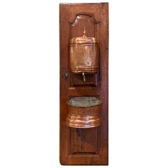 18th Century French Brass Lavabo Fountain from Normandy on Carved Cherry Door