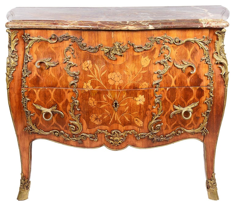 A very good quality French 18th century marquetry bombe commode, having its original marble top, underneath (stamped P.Bernard, Maitre Ebeniste) gilded ormolu mounts and handles, (stamped G.P) The drawer fronts and bombe sides having wonderful