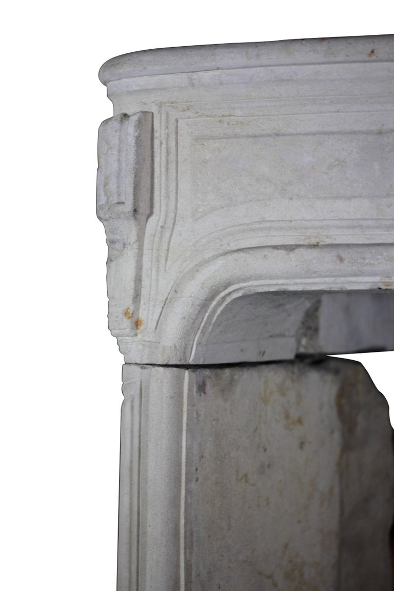 Fine French original antique fireplace surround in limestone from the early Regency period. The jambs have Louis XIV period details. Perfect to create a European country room. Measures: 166 cm EW 65.35