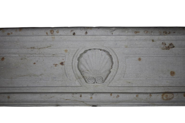 Carved 18th Century French Country Regency Period Limestone Fireplace Surround For Sale