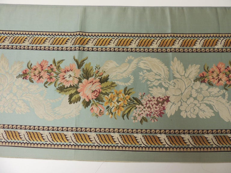 18th century French floral green and pink satin silk brocade textile. Unique woven silk textile depicting flowers and a twisted design border. Narrow woven textile. Depicts flowers in bloom with bows, ribbons and acanthus leaves borders. In